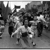 Henri Cartier Bresson CHINA. Shanghai. 1949. Students dancing the Yanko during a parade. 215x215 Photos of Henri Cartier Bresson